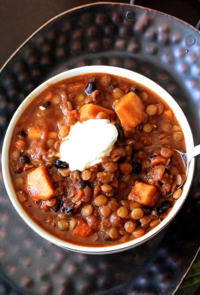 This sweet potato, black bean, and lentil chili is healthy and hearty– you'll never miss the meat!