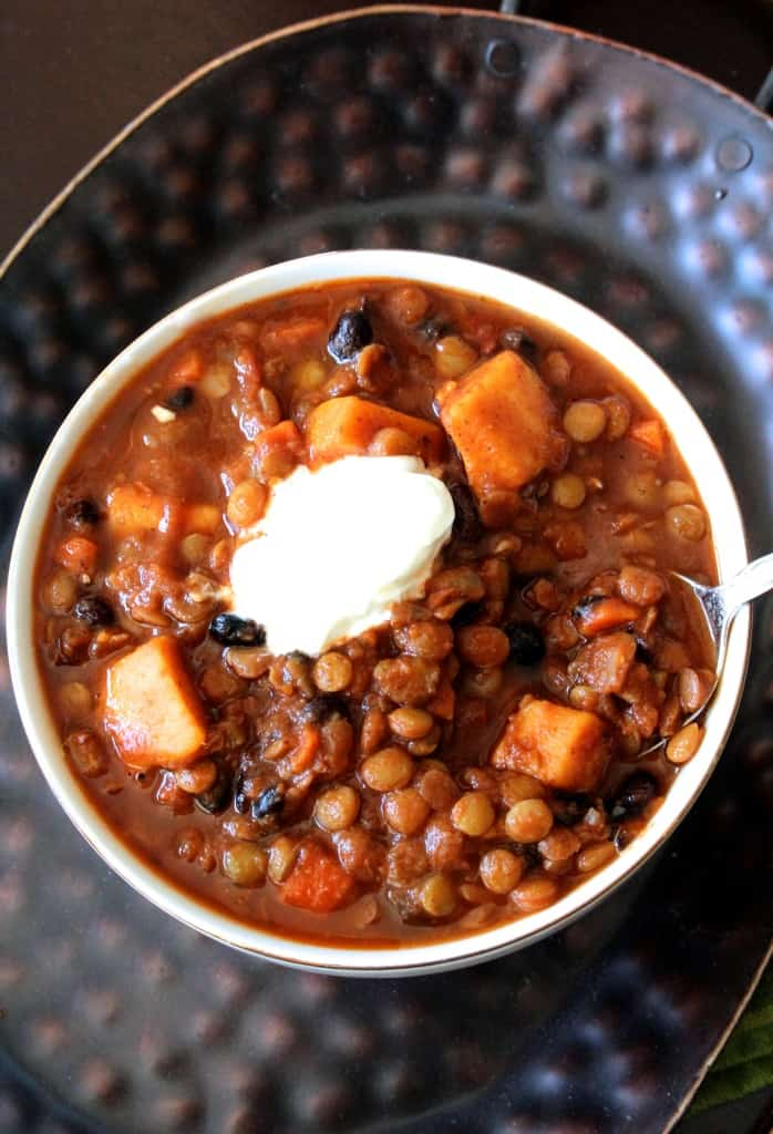 This sweet potato, black bean, and lentil vegetarian chili is healthy and hearty– you'll never miss the meat!