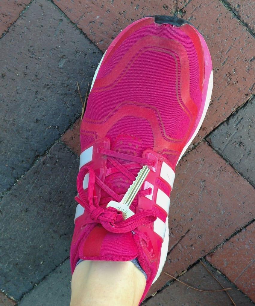 key tied to running shoe