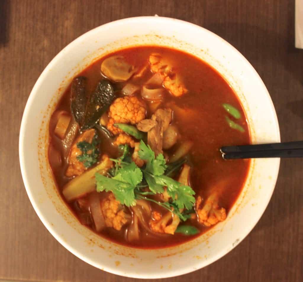 tom kai gha eating in indonesia spicy