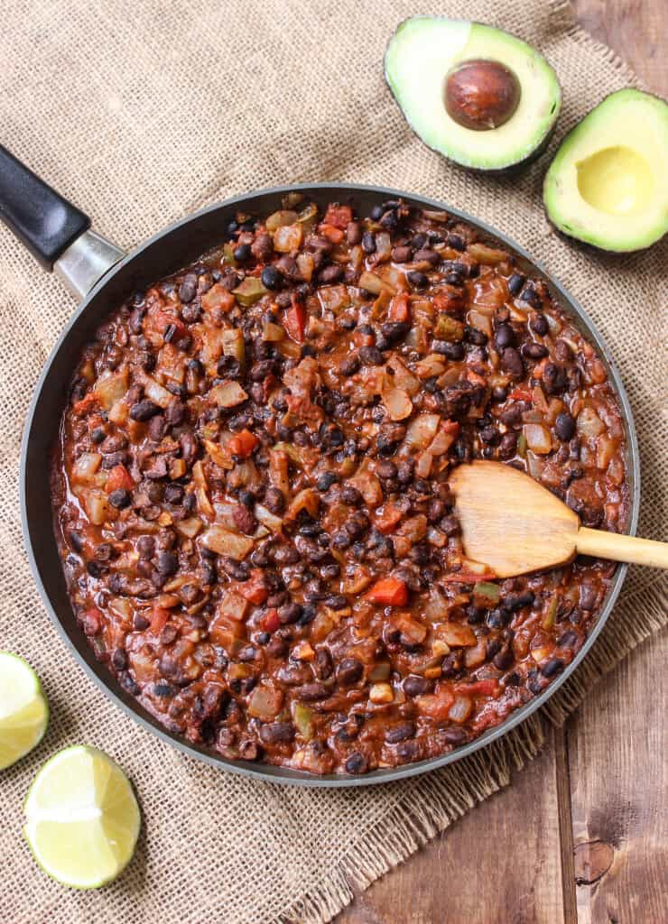 Dressed-up black beans and rice that takes 25 minutes to make! Affordable college student meal that's also delicious