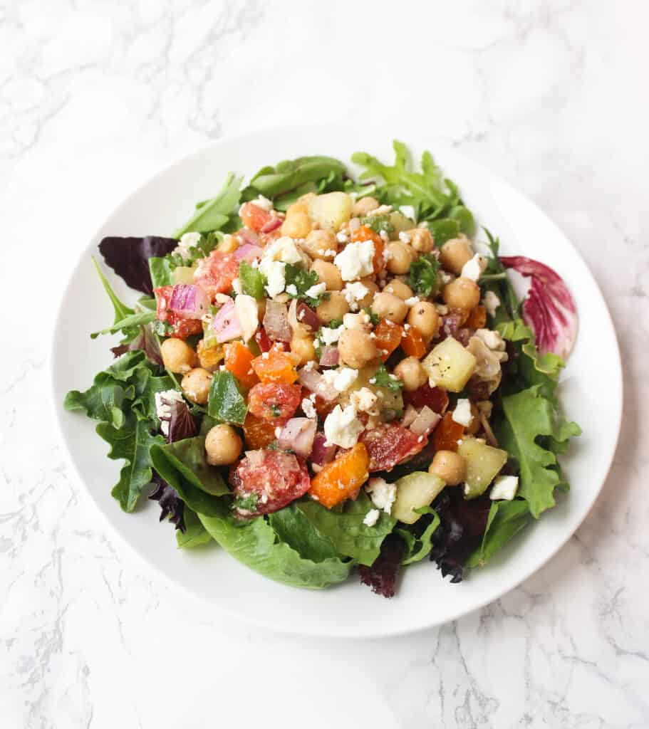 Greek Chickpea Salad LOADED with toppings - it's a simple and healthy meal to whip up! | www.healthy-liv.com