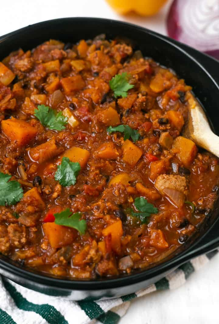 A pot of Butternut Squash Turkey Chili with cilantro