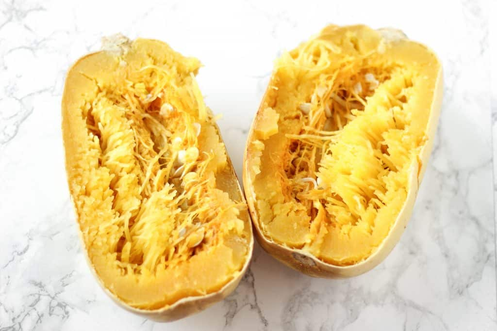 This baked spaghetti squash with Italian chicken sausage has just 326 calories for a huge serving!