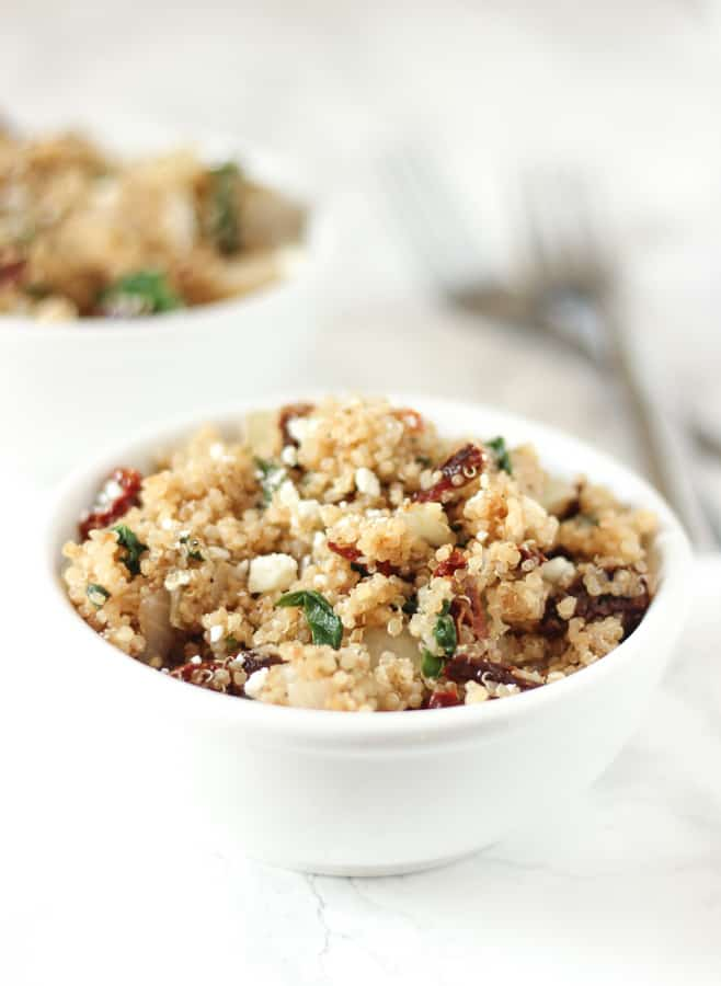 This Mediterranean Quinoa is packed with sun-dried tomatoes & feta! It's a super easy side or main dish