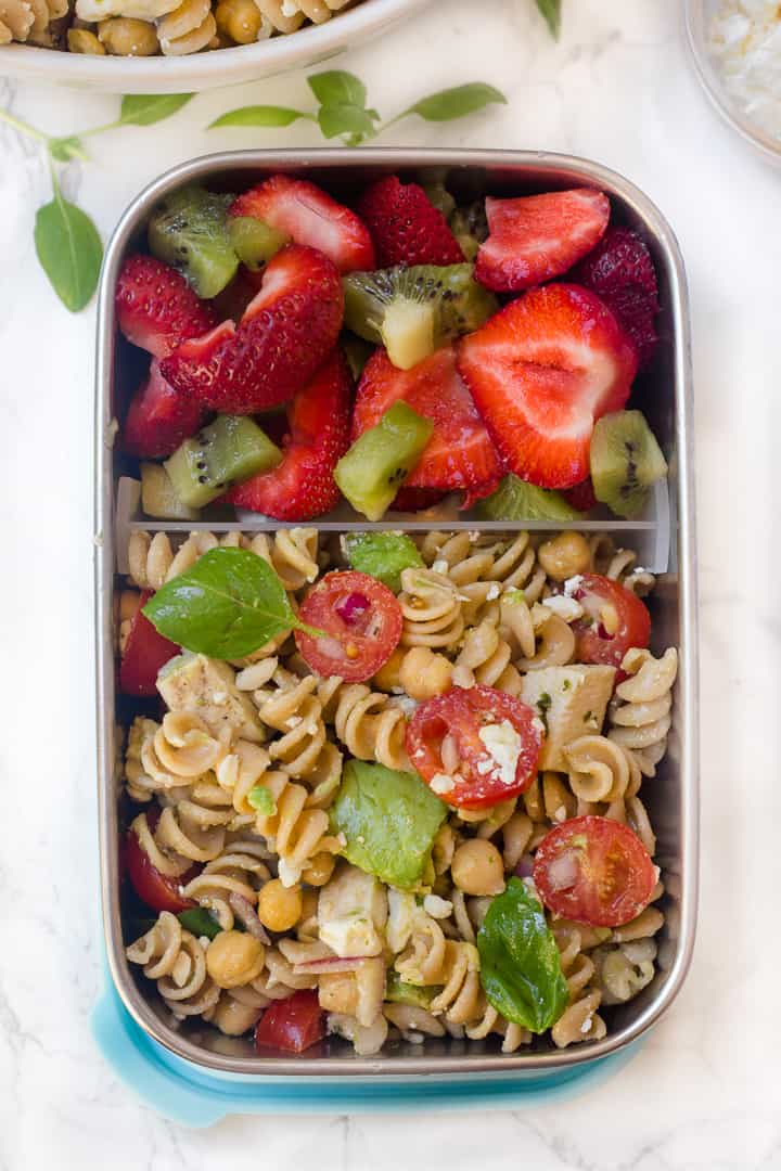 Avocado Chickpea Feta Pasta Salad with Basil Vinaigrette in a stainless steel lunch container
