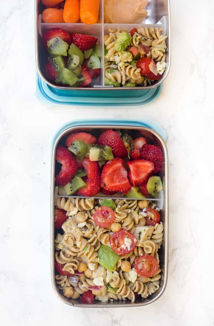 Avocado Chickpea Feta Pasta Salad with Basil Vinaigrette in a stainless steel container