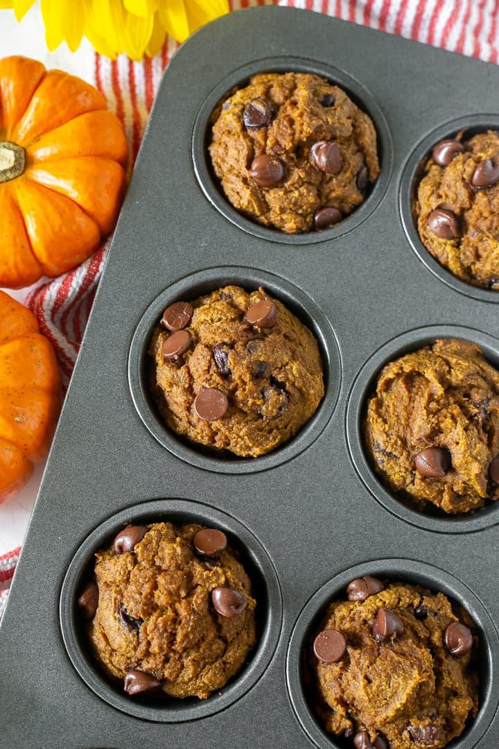 A pan of healthy flourless chocolate chip pumpkin muffins
